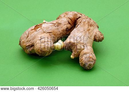 Dry Organic Ginger Root Spice On Green Background