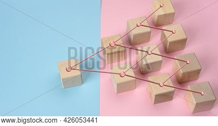 Wooden Blocks On A Pink Blue Background, Hierarchical Organizational Structure Of Management, Effect