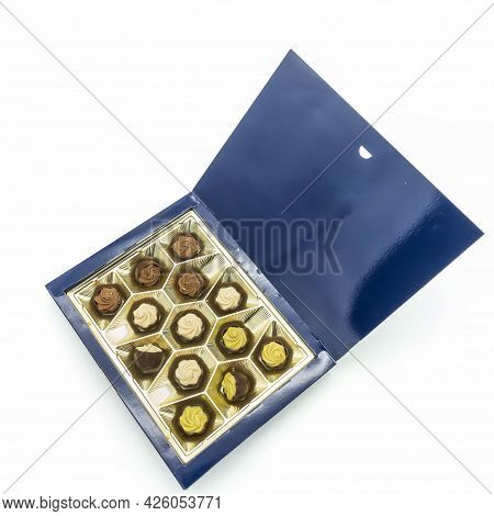 Opened Blue Cardboard Box With Chocolates. Golden Packaging. Sweets With Cream And Pistachio Filling