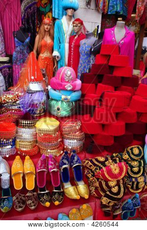 Traditional Slippers, Fez And Caftan On Display