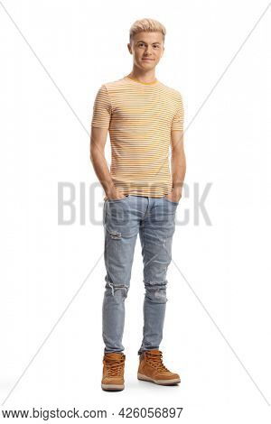 Full length portrait of a teenage boy with bleached hair isolated on white background