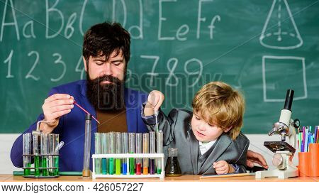 Perseverance Pays Off. Teacher And Child Test Tubes. School Lesson. Chemical Experiment. Symptoms Of