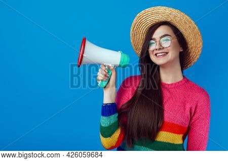 Excited Lgbt Activist Leader Girl In Rainbow Sweater Speaking In Megaphone And Smiling While Standin