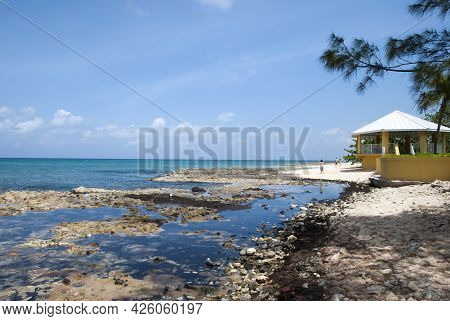 The View Of Seven Mile Beach Rocky Shore On Grand Cayman Island (cayman Islands).