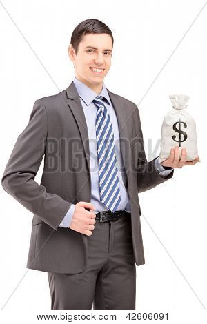 Happy young businessman holding a bag with US dollar sign, isolated on white background
