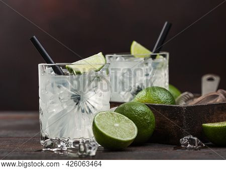 Gimlet Kamikaze Cocktail In Crystal Glasses With Lime Slice And Ice On Wooden Background With Fresh