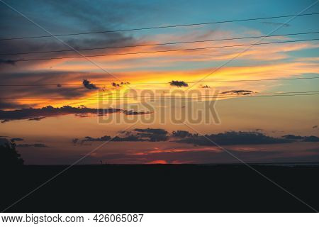 Incredibly Beautiful Sunset With A Yellow-blue Sky. Beautiful Sky At Sunset. Wonderful Sunset By The