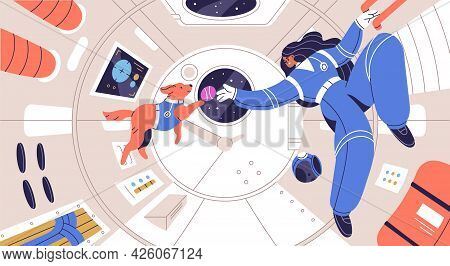 Weightless Cosmonaut Floating With Dog In Spaceship Cabin. Zero Gravity And Weightlessness Concept.