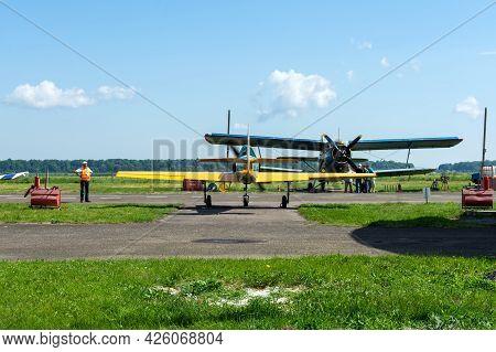 Gorodok. Ukraine. June 6, 2021. Tsuniv Airfield. Biplane, And A Training Aircraft, Parked At The Air