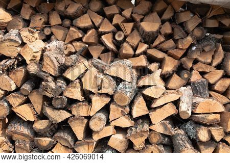 Stacked Firewood Background. Firewood Pattern. Wood Saving Wall. Stock Of Wood For Kindling A Firepl