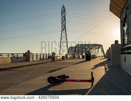 Nashville, Tennessee - 28 June 2021: Spin Electric Scooter Abandoned On Pedestrian Bridge Near Broad