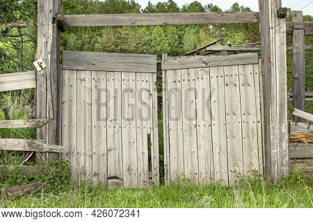Old Wooden Gate In An Abandoned Village Manor