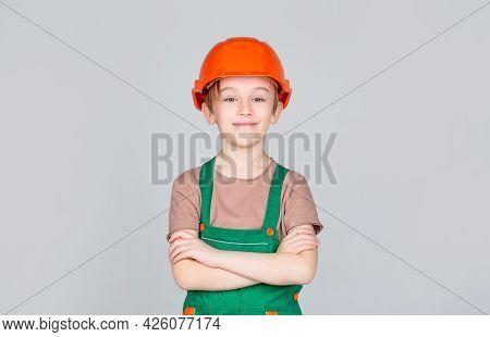 Portrait Little Builder In Hardhats. Child Building Helmet, Hard Hat. Little Builder In Helmet. Chil