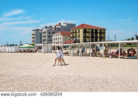 Zaliznyi Port, Ukraine - July 23, 2020: A Group Of Girls Walking Along The Beach In Zaliznyi Port. B