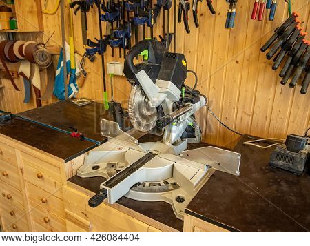 Carpentry Workshop. Joiner's Machines. Cutting-off Circular Saw In The Foreground.
