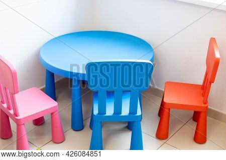 Childrens Area For Leisure Activities Of Younger Children. Table And Chairs Of Blue And Red Colors
