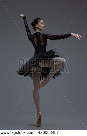 Backview Shot Of Woman Artist Dancing Inside Studio