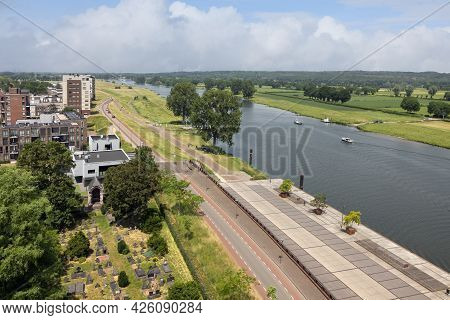 Aerial View Dutch Village Cuijk With Riverbank Along River Meuse