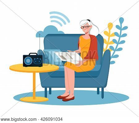 Concept Of Listening To Music On The Radio. A Retired Woman Is Sitting On The Sofa, Reading A Newspa