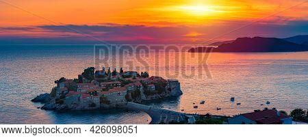 Panorama Of Sveti Stefan Island Near Budva On A Beautiful Summer Day At Sunset. Montenegro, Balkans,