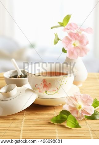 Porcelain Cup Of Tea Stands On The Table In The Sun