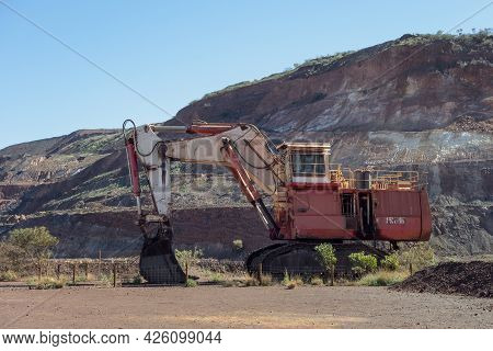 Tom Price, Western Australia - July 9, 2018: Red Excavator In Tom Price Iron Ore Mine In Pilbara Reg