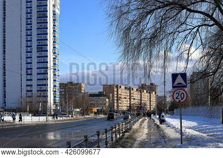 Balashikha, Russia - March 19, 2021. Residential Neighbourhood On The Spring Sunny Day. Dirty Sidewa