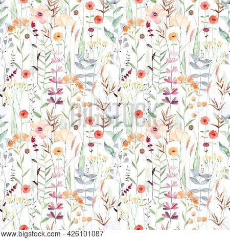 Beautiful seamless pattern with different wild flowers. Watercolor background for fabric, textile, nursery wallpaper. Meadow with wild flowers.