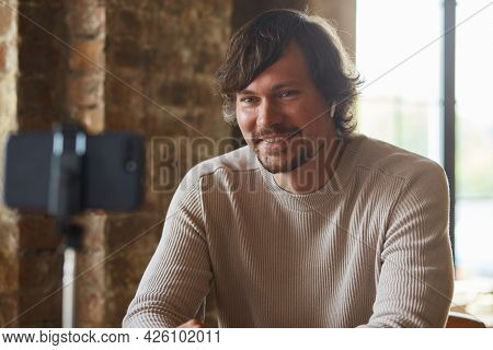 Male Vlogger Influencer Sit At Home Speaking Looking At Camera