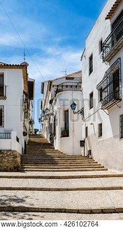 Altea Old Town, Spain. Beautiful Village With Cobblestoned Narrow Step Street, Typical Mediterranean