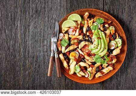 Mexican Chicken Strips Salad Of Black Beans, Cilantro, Radish, Carrot, Cucumber, And Avocado With Ta