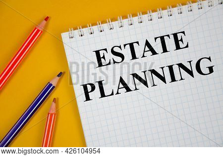 Estate Planning - Business Concept Word Written On White Notepad And Yellow Background