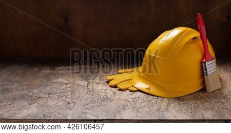 Construction tools at wooden table background texture. Tool kit on tabletop concept of repair