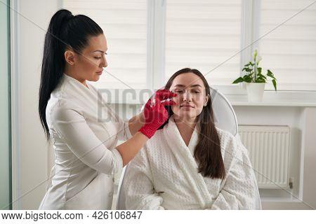 Cosmetologist Making Injection In Female Face, Closeup. Biorevitalization Procedure