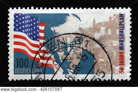 ZAGREB, CROATIA - AUGUST 29, 2014: A stamp printed in Germany shows United States flag, George Marshall and bomb site, 50th Anniversary of the Marshall Plan, circa 1997