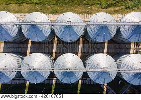 Grain Storage In Large Slots Aerial View. Silo With Grain. Grain Storage Tank View From Above.