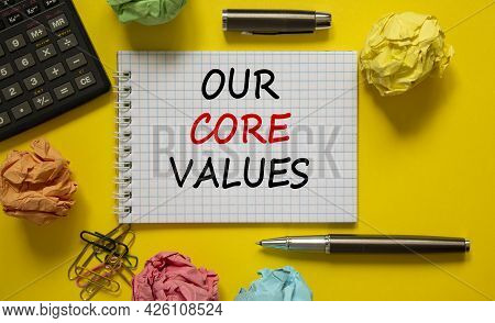 Our Core Values Symbol. White Note With Words 'our Core Values' On Beautiful Yellow Table, Colored P