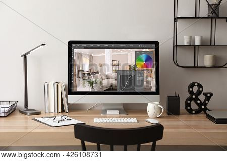 Designer's Workplace. Computer With Photo Editor Application On Table Indoors