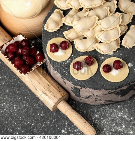 Raw Sweet Dumplings Stuffed With Cherry. Convenience Food. Cooking Process. Slices Of Dough With Fil