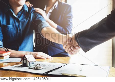 Focus On The Congratulatory Handshake. The Real Estate Agent Agrees To Buy The Home The Customer At