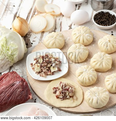 Dumplings Stuffed With Minced Meat And Cabbage. Convenience Food. Cooking Process. Slices Of Raw Dou