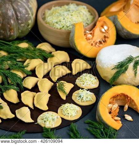 Pumpkin Dumplings Stuffed With Eggs And Dill. Raw Dough And Ingredients For Making Dumplings On Kitc