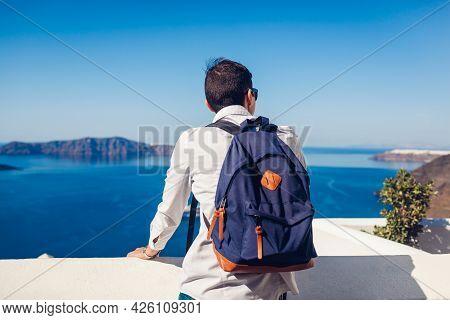 Santorini Traveler Man Enjoying Caldera View From Fira Or Thera, Greece. Tourism, Traveling, Summer