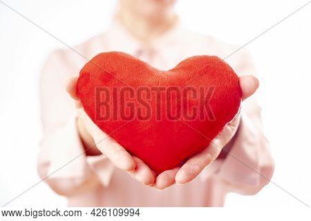 Woman Holds Plush Heart, Female Love. White Background