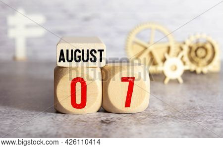 Cube Shape Calendar For August 07 On Wooden Surface With Empty Space For Text
