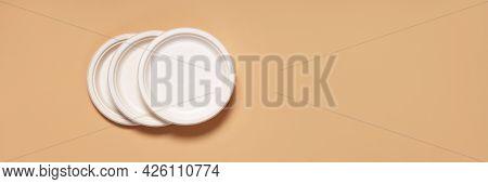 Banner Eco-friendly Three-piece Cornstarch Dinner Plate On Beige Paper Background Close-up Copy Spac