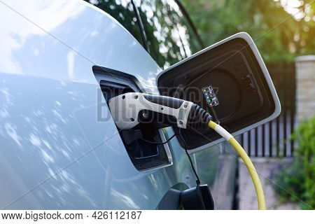 Power Supply For Electric Car Charging At Home. Close Up Of Power Supply Joined To Modern Electric C