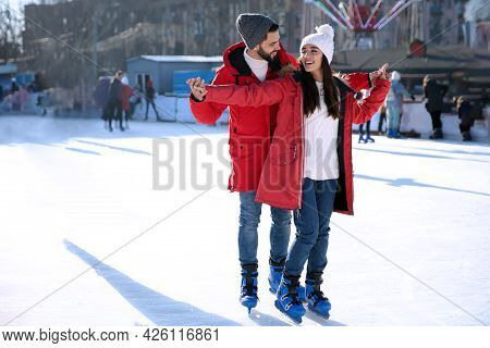 Lovely Couple Spending Time Together At Outdoor Ice Skating Rink