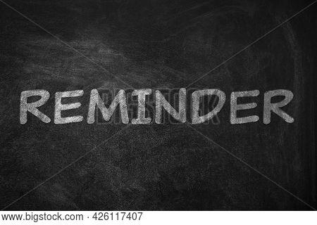 Word Reminder Written On Blackboard. Don't Forget