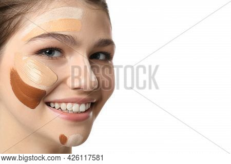 Beautiful Girl On White Background, Closeup. Using Concealer And Foundation For Face Contouring